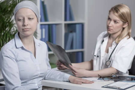 bad color: Young doctor with bad news for her cancer patient Stock Photo