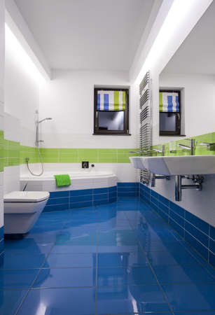 handbasin: Blue and green tiles in modern bathroom Stock Photo