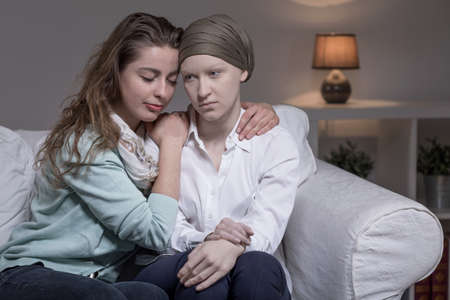 medical person: Young sick cancer woman and her supportive friend Stock Photo
