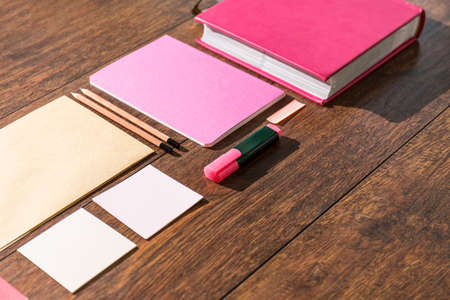 desk tidy: Pink tools prepared on wooden desk office for paperwork Stock Photo