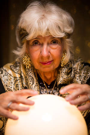 mystique: Photo of fortune teller predicting future from crystal ball