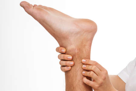 Close-up of physical therapist palpating Achilles tendon