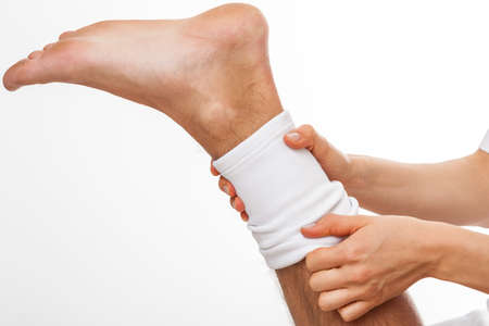 sprain: Patient with ankle sprain using stabilizer after rehabilitation