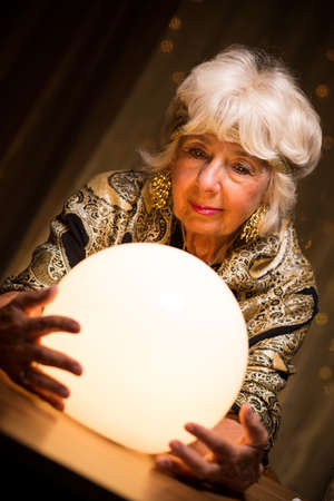 magic ball: Portrait of female seer holding crystal ball