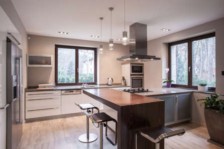 Horizontal view of spacious modern kitchen interior Standard-Bild