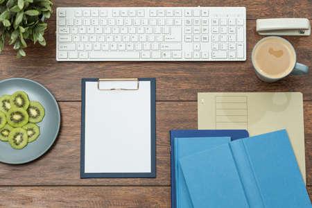 arranged: Well arranged wooden desk full of paperwork Stock Photo