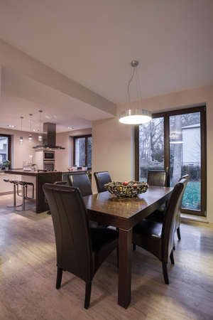 dining table and chairs: Wooden dining table and brown leather chairs