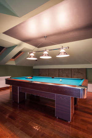 snooker room: Close-up of pool table in game room