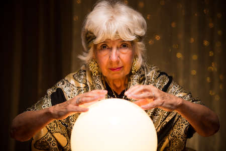 spiritualism: Image of elder mystique woman with magic crystal ball