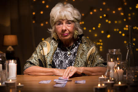Picture of mature fortune teller with tarot cards Stock Photo