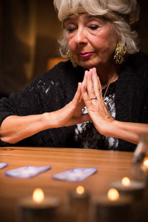 seance: Image of grey magic woman during spiritualistic seance