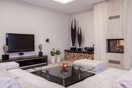 tv on wall: Sitting room with plasma TV and fireplace Stock Photo