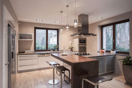 contemporary kitchen: Interior of designed kitchen in modern house Stock Photo
