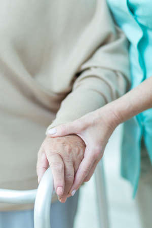 close   up: Close up of medic holding aged patients hand