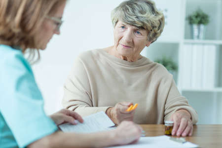 Picture of worried aged feamle on medical consultation