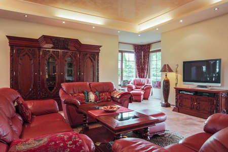 living style: Leather claret seat in exclusive sitting room Stock Photo