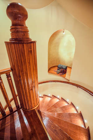 wooden stairs: Spiral wooden stairs in traditional elegant house Stock Photo