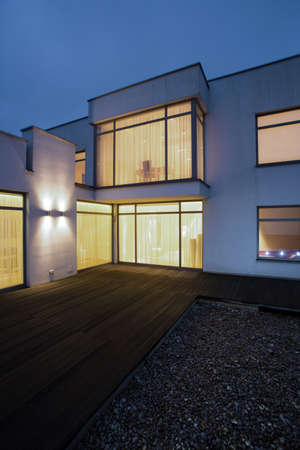 home design: Illuminated windows in detached house - picture done at night