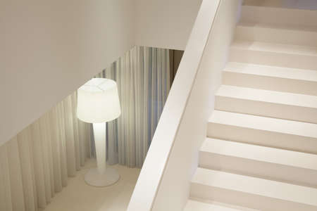 lamp light: Close-up of white stairs in luxury apartment