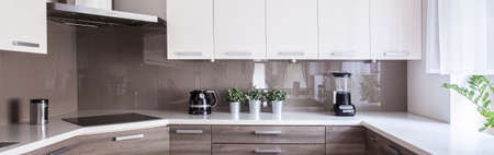 kitchen furniture: Picture of beige and white kitchen design Stock Photo