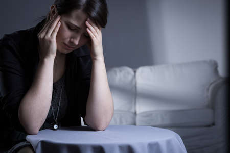 mental disorder: Crying widow having trauma after her husbands death Stock Photo