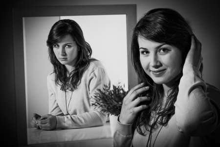 complexes: Pretty smiling woman hiding her biggest complexes Stock Photo
