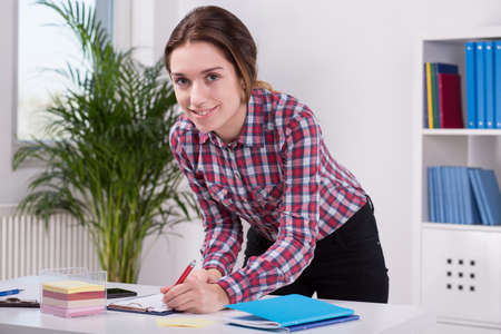 bureau: Horizontal view of woman working in bureau Stock Photo