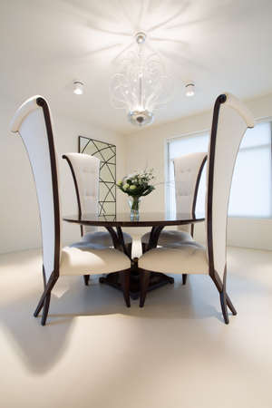 roundtable: Wooden round table in exclusive dining room