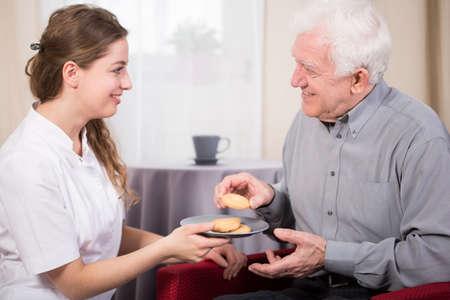 sanitarium: Pensioner and his nurse during free time in sanitarium Stock Photo