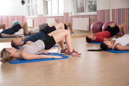 pilates woman: View of workout on a foam mattress Stock Photo