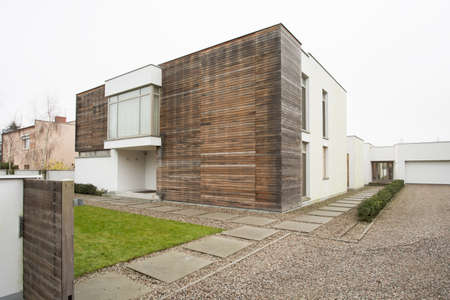 building external: Exterior of luxury detached house during autumn time