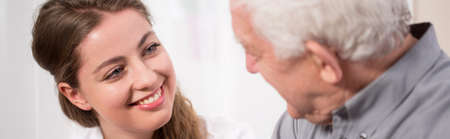 honest: Young woman smiling to elder man