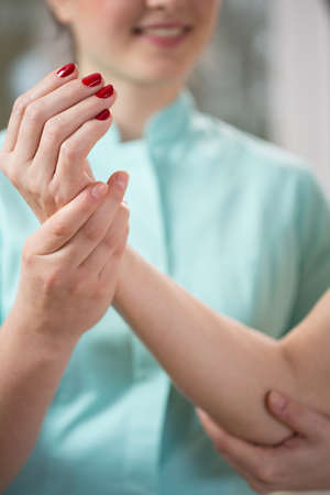 mobilization: Close-up of therapist exercising with patients arm