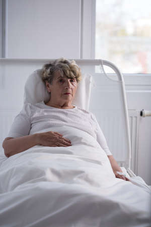 hospice: Lonely senior sick woman left in hospice Stock Photo