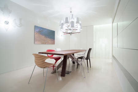 dining table and chairs: Various chairs in dining room in modern design