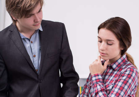 Young male manager talking with worried employee