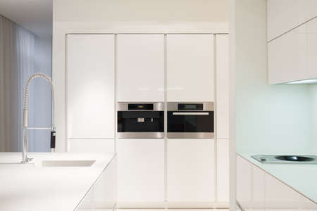 Housing oven and microwave in modern kitchen