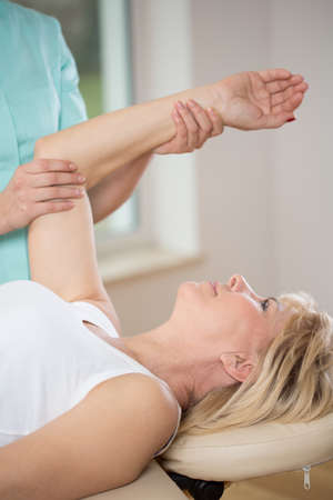 physiotherapists: Elderly woman exercising at female physiotherapists office