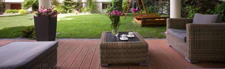 verandah: Horizontal view of verandah with wicker furniture