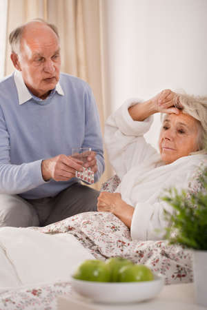 taking a wife: Older worried man taking care of his sick wife Stock Photo