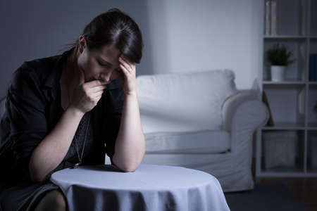 single person: Depressed young widow trying to live with partners death Stock Photo