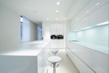home lighting: White beauty kitchen interior in luxury home