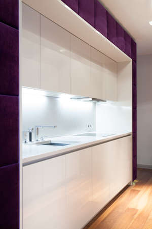 kitchen countertops: White kitchen unit in luxury detached house Stock Photo