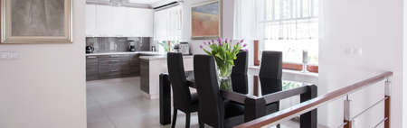roomy: Panorama of dining table in elegant interior Stock Photo