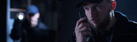 shortwave: Officer is calling for a back up on shortwave radio Stock Photo