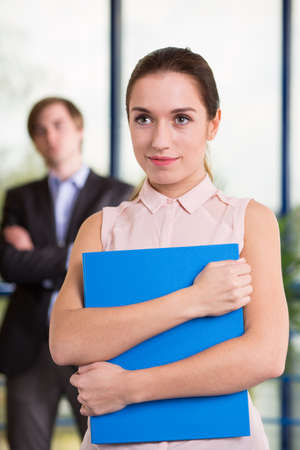 Clerical worker holding folder with important documents Stock Photo