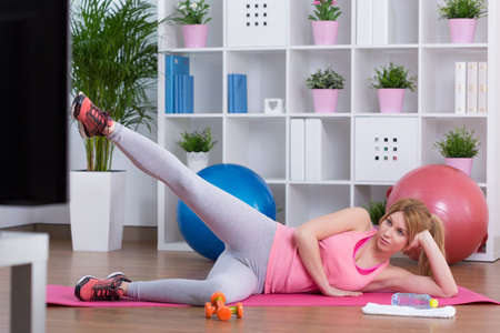 working out: Beauty sporty woman working out at home Stock Photo