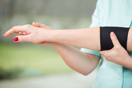 elbow band: Close-up of arm with stabilizing band Stock Photo