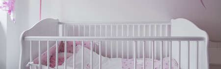 baby crib: Close-up of white crib in baby room