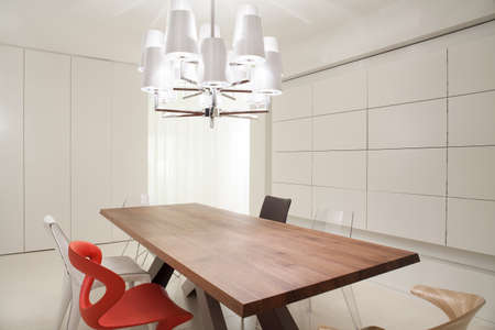 modern interior: Close-up of designed chandelier in dining room